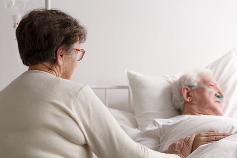 Watching her husband dying
